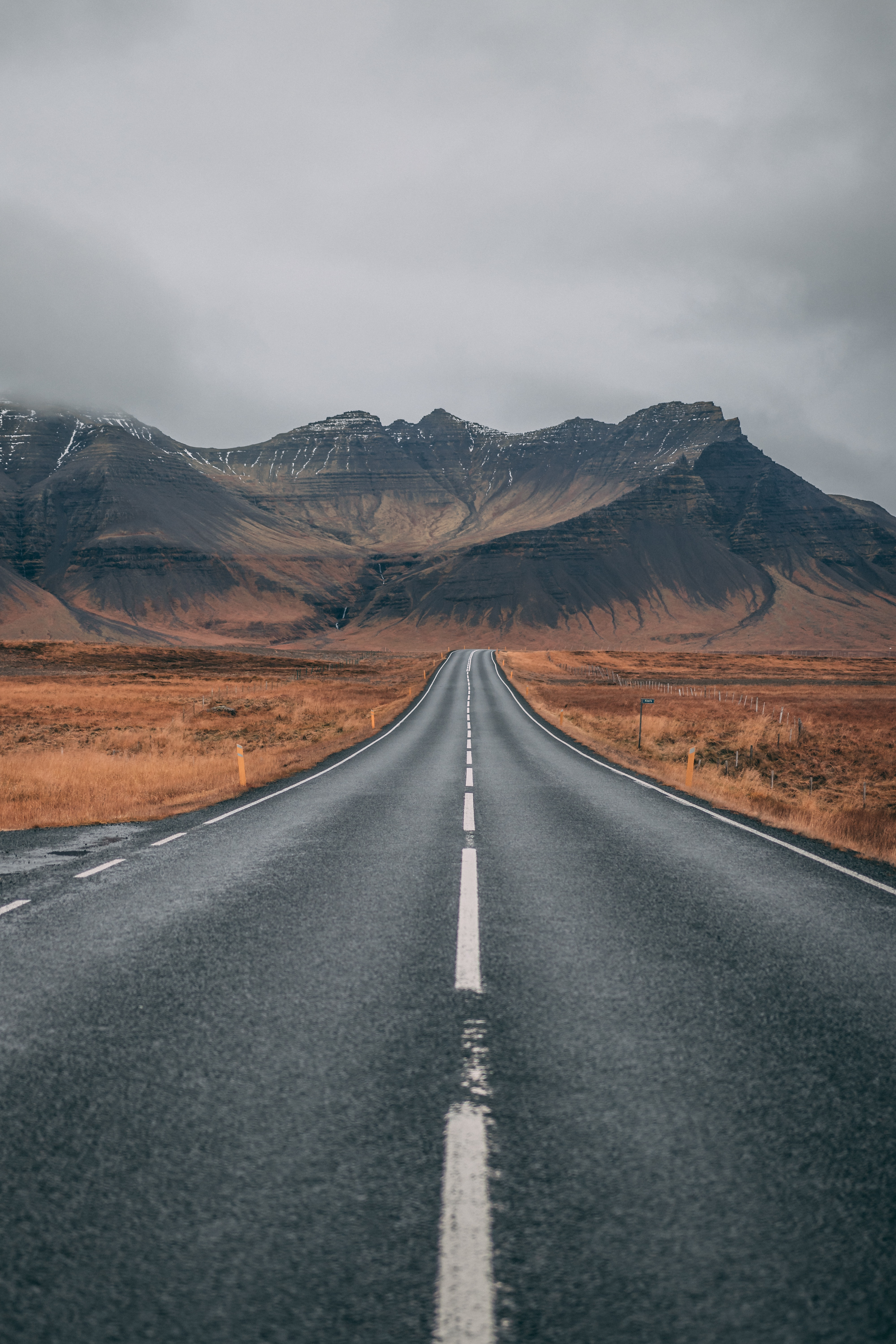 The open road to the mountains sparks idea of adventure