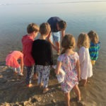 Children exploring the sea